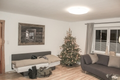 Wohnzimmer Sofa Ambiento Tirol Apartment Ferienwohnung Kirchbichl